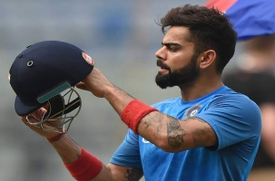 Kohli admits heavy 'workload' taking toll on his body